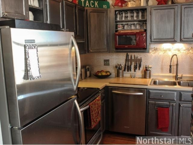 Kitchen cabinets painted with Rust oleum metallic accents, color Real