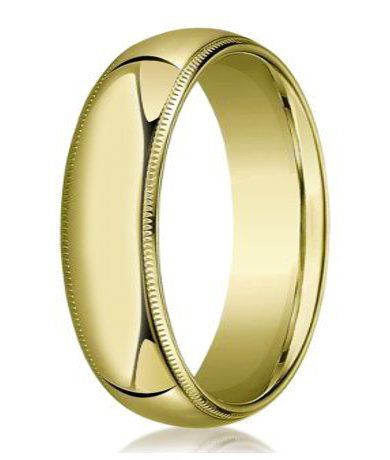 Understated yet eye-catching, this men's designer gold wedding ring is a true classic. Offering a polished and slightly domed shape, this men's wedding band in 10K yellow gold is trimmed with intricate milgrained edges. A 7mm comfort fit band infuses a timeless look with ease of wear. Web Page:  http://www.justmensrings.com/Designer-7-mm-Domed-Milgrain-Polished-Finish-with-Comfort-fit-10K-Yellow-Gold-Wedding-Band--JB1045_p_64.html