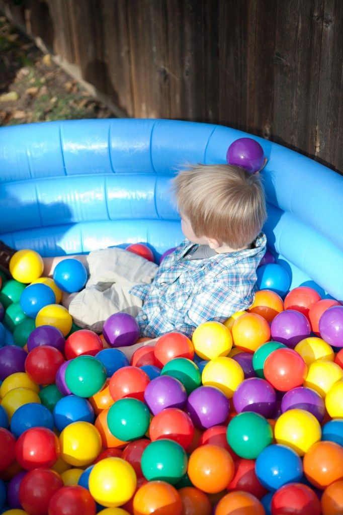 Perfect activity for a #firstbirthday - inflatable baby pool filled with ball pit balls!