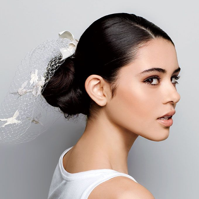 low maintenance hairstyles for thick hair : Sleek Low Bun Wedding Hairstyle