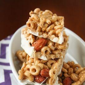Homemade Honey Nut Cheerios Bars dipped in white chocolate