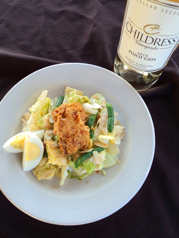 . Iceberg salad with green beans, almonds, hard-boiled eggs, fried ...