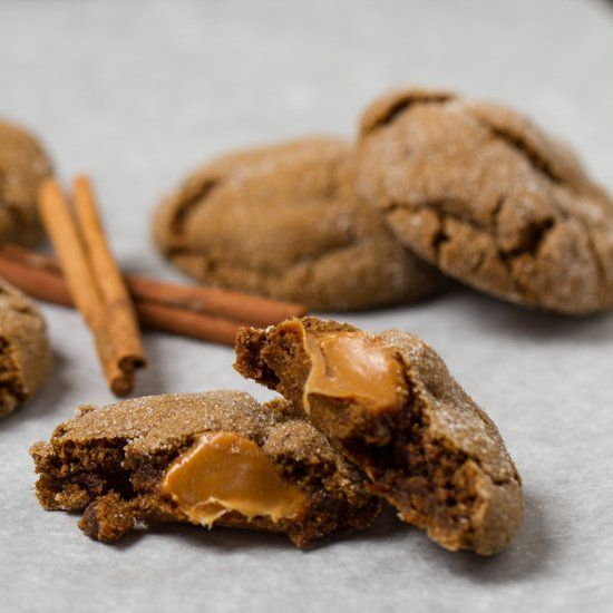 , soft and chewy ginger molasses cookies stuffed with gooey caramel ...