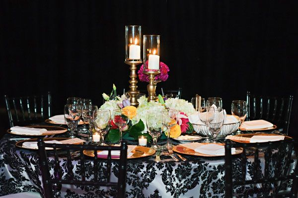 Pairing a simple centerpiece with a dramatic tablecloth strikes the perfect balance!