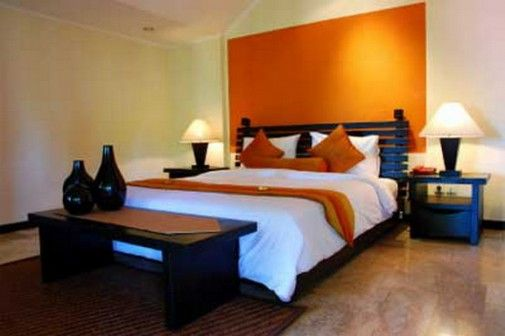 Exotic orange bedroom wall paint color home pinterest for Orange colour bedroom