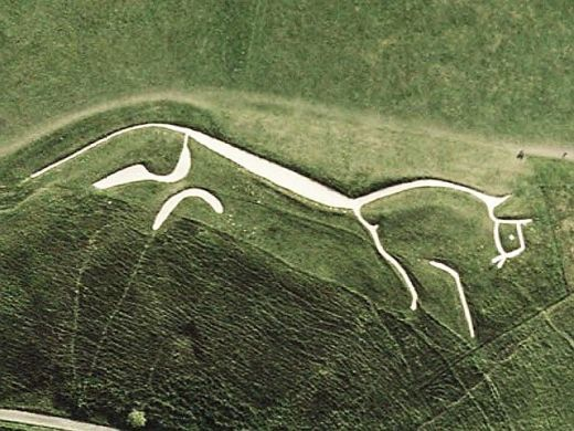 This Bronze Age, 374 feet (110 m) long, 3000 year old, man-made, prehistoric Hill Figure is located in Uffington England. The figure is deeply carved onto the hillside and packed with white chalk. Traditionally the figure was religiously 'scoured' every 7 years by the local community removing all weeds and encroaching vegetation thereby maintaining its pristine silhouette for three eons. It can only be made out from the sky and the reason for its existence is pure speculation.