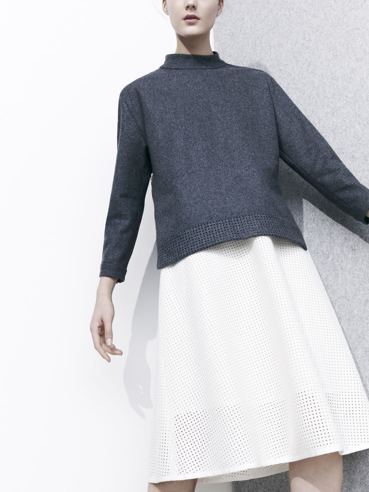 J.Crew Collection perforated top in heather carbon and  perforated skirt in warm ivory.