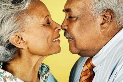 Affectionate Senior Couple Rubbing Noses --- Image by © Ned Frisk Photography/Corbis © Corbis. All Rights Reserved.