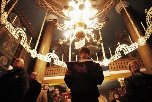 Bosnian serbs pray during the eve of orthodox christmas in the
