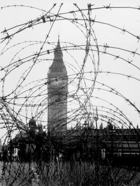 Big Ben & Houses of Parliament behind webbing of barbed wire during WWII. London, 1940.