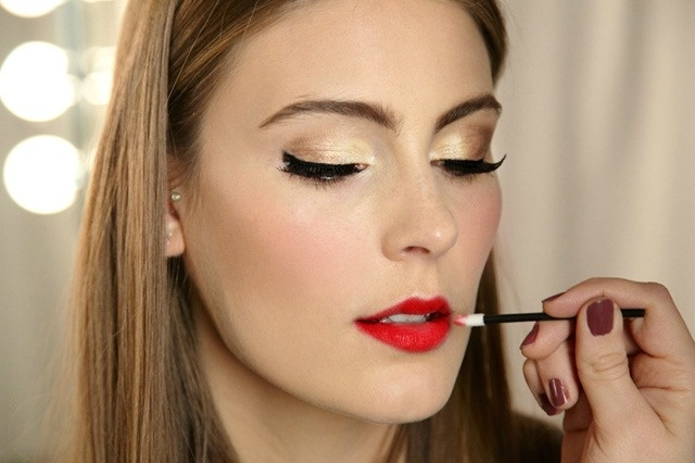 Love the gold eye make up and red lips, Perfect for the Holidays