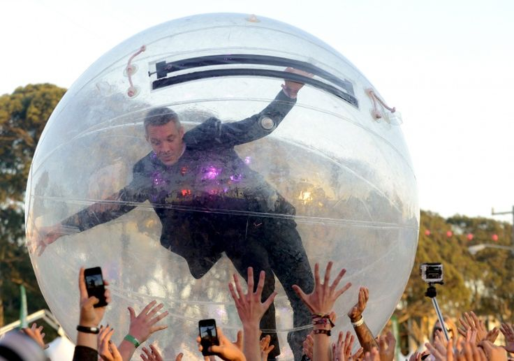 """""""Don't drop me!"""" Diplo of Major Lazer takes crowd surfing to another level during a performance at the Treasure Island Music Festival on Oct. 19 in San Francisco"""