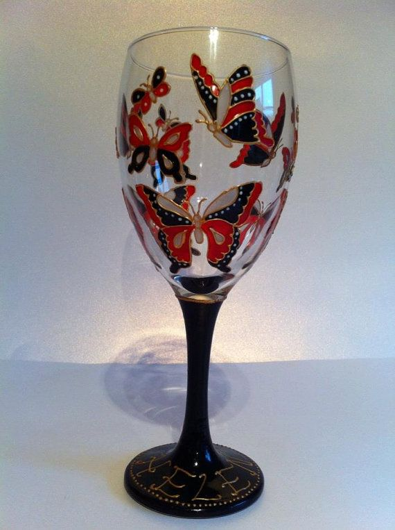 Hand painted wine glass painted with a butterfly design in for Hand designed wine glasses