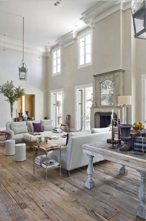 Love this interior, white contrasting with wood floors, high ceilings, pendant lights.