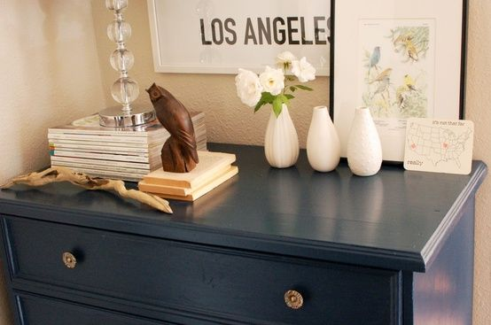 Navy dresser, styled beautifully!  (Love the three bud vases)