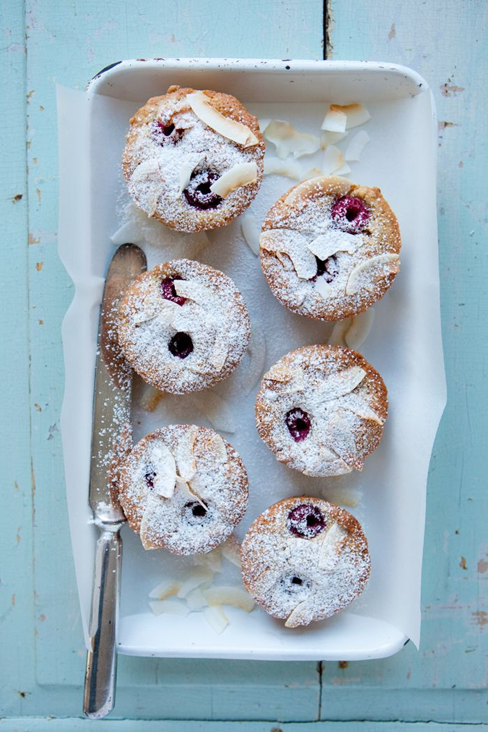financiers with coconut sugar, raspberries and roasted coconut chips