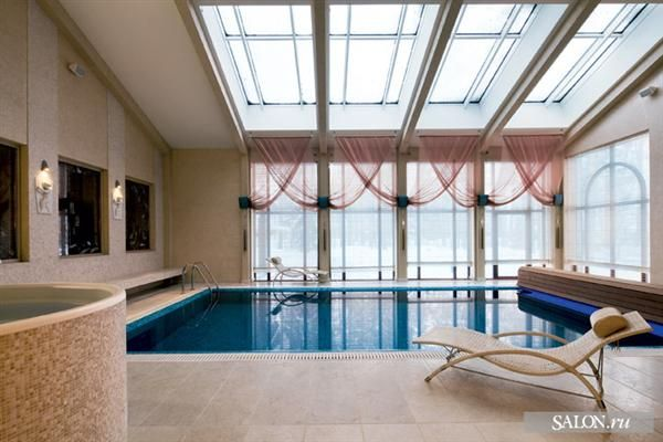 Indoor swimming pool custom designs indoor climate for Custom indoor pools