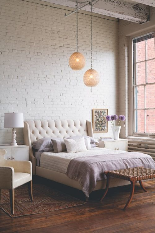 Romantic, modern bedroom in whites and pale lavendars with white painted brick wall and softly, glowing pendant lights. Crazy about it! :)