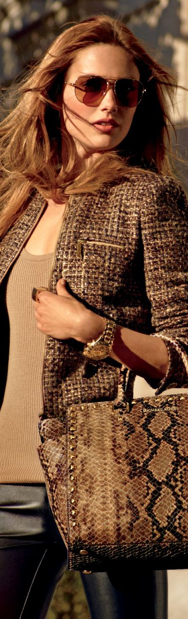 Brown cardigan with leahter pants and handbag