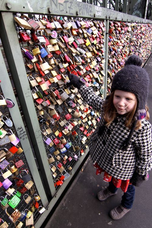 Have you ever been to a love lock bridge? Lovers carve their initials in a padlock, attach it to the bridge, and throw away the key. This one is in Cologne Germany. i really want to go to one of these!