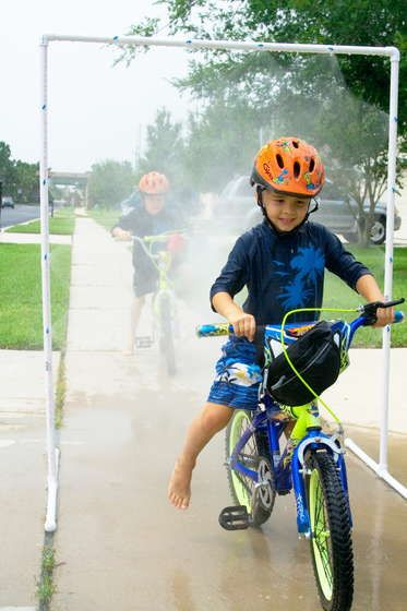 Smaller one...  Simple PVC sprinkler that the kids can ride through on their bikes! My boys would love this and even the youngest on the trike could join in! Nice instructions here- click the thumbnail for step one :)