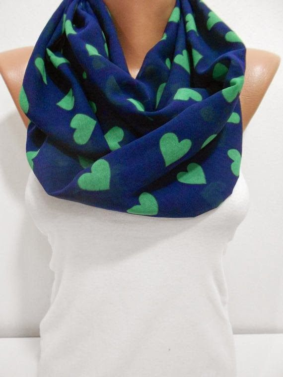 Fashionable blue scarf with heart print on it