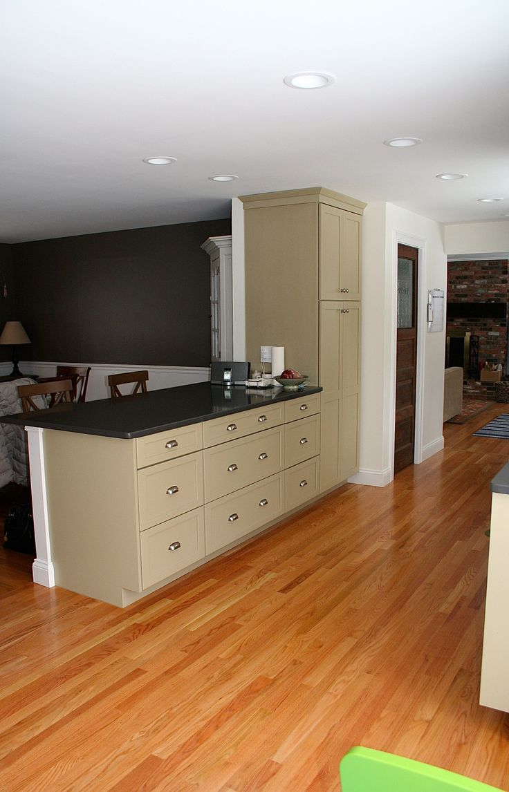 Kitchen featuring Shaker Style white and celadon kitchens cabinets