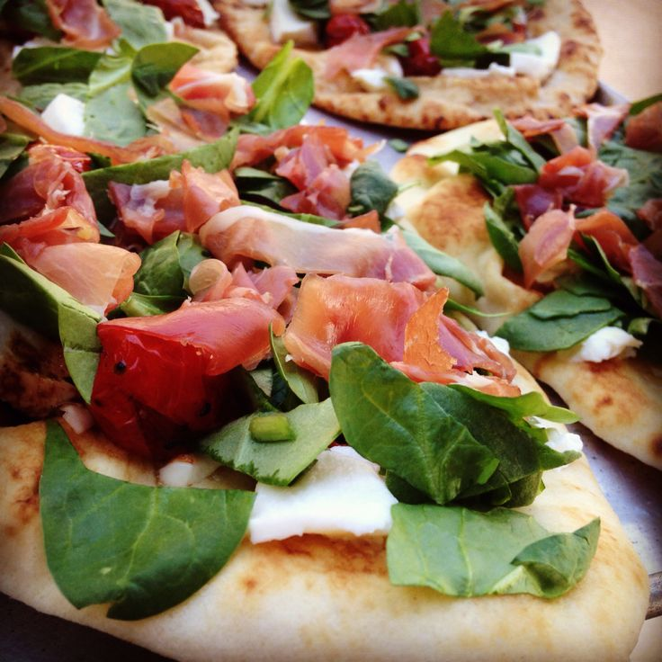Grilled naan pizza. Spinach, roasted garlic evoo, prosciutto, balsamic ...