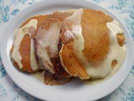 ... and Cafe's Bread Pudding Pancakes with Vanilla Custard Sauce