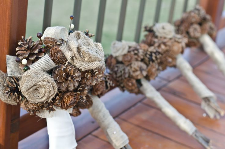 burlap bows and pine cones are a rustic and lasting choice for wedding bouquets - thereddirtbride.com - see more of this wedding here