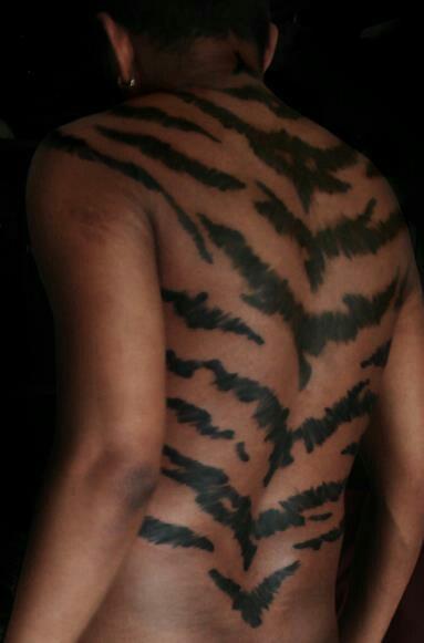 Tiger stripes side tattoo