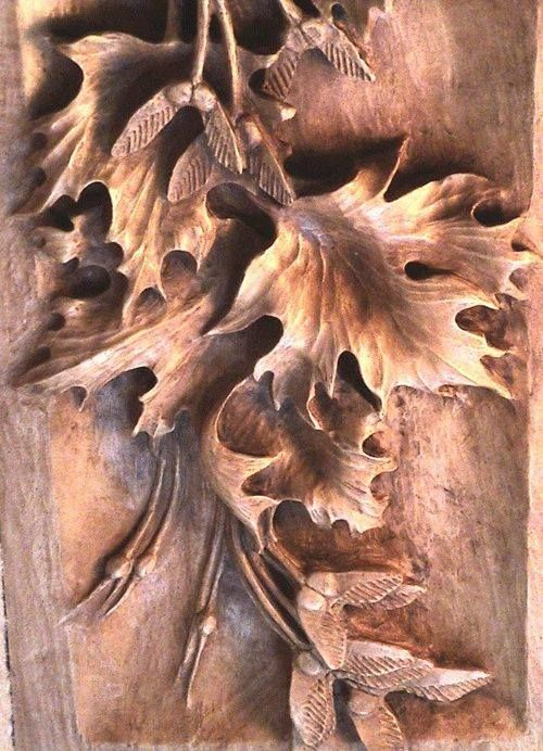 Wooden maple leaves and seeds carving