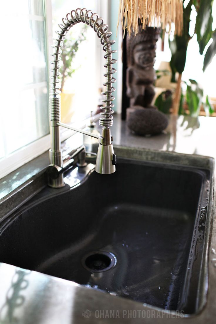 ... with black Franke composite granite sink-fawcet for pots and pooches