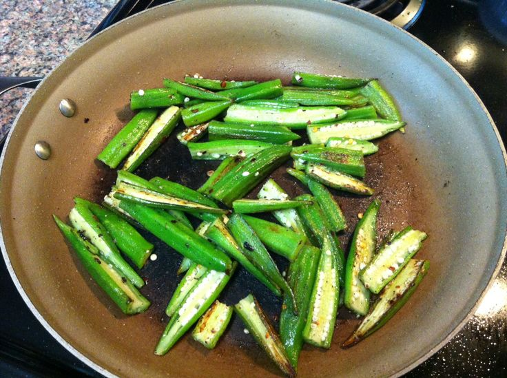 pan fried okra•12 oz okra (I used a bag of frozen okra, thawed in the fridge)   •Coconut oil   •Salt   •Pepper   •Crushed red pepper flakes   1.Slice the okra in half lengthwise.   2.Heat 1 tbsp oil in pan over medium-high heat.   3.Add half of the okra and season them.   4.Cook okra, turning often, until browned and partly crispy.   5.Do the next batch.