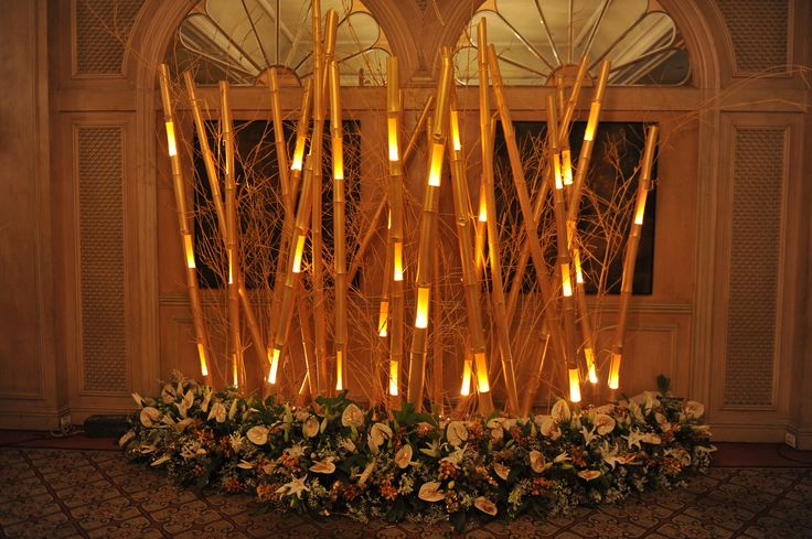 Bamboo sticks and flowers decor flower decor pinterest for How to decorate bamboo sticks