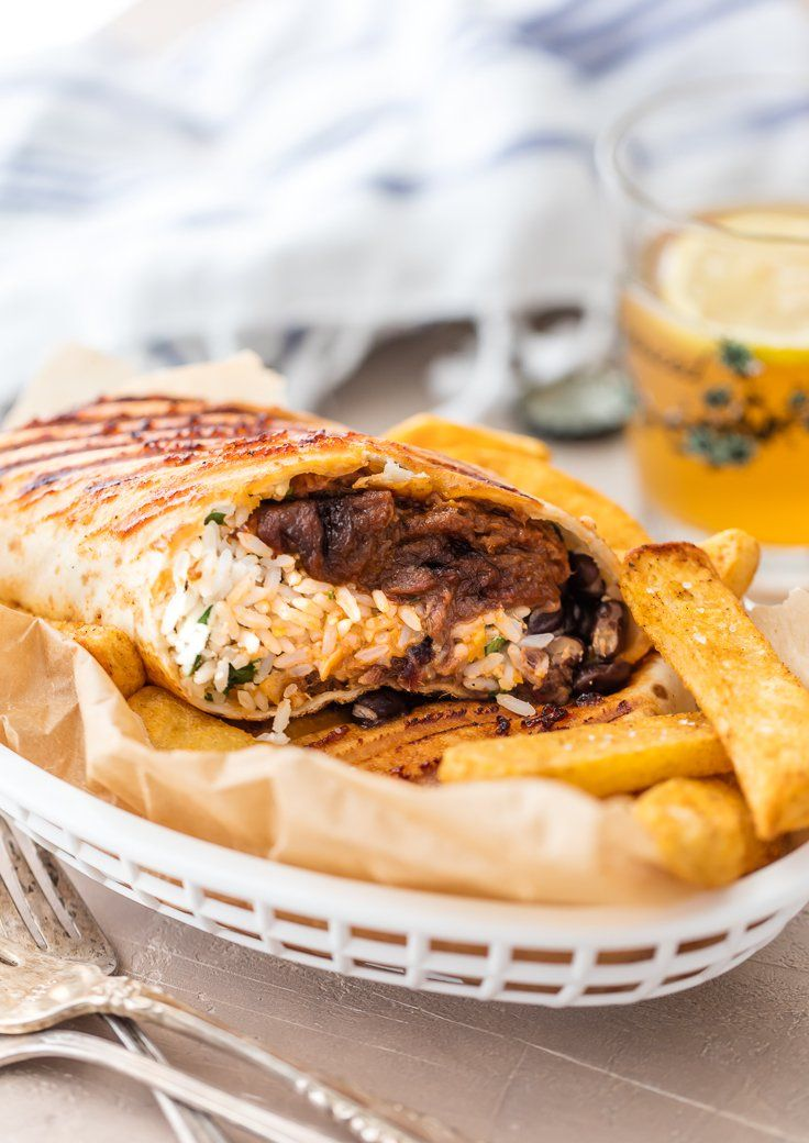 GRILLED BBQ BRISKET BURRITOS are made in under 20 minutes and stuffed with slow cooked, hand pulled Farm Rich Smokehouse Beef Brisket, Cilantro Lime Rice, black beans and tons of cheese... YUM! #99DaysofBBQ