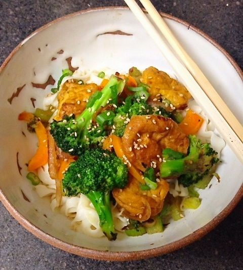 Braised tofu with broccoli, orange pepper, and onions served with tofu ...