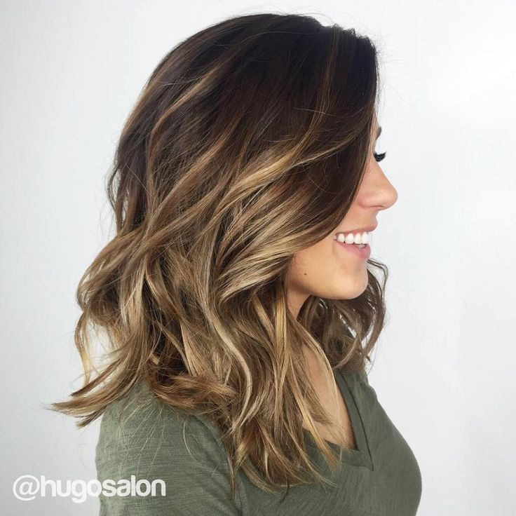 Dark brown hair with golden highlights underneath pictures