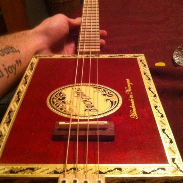 The brickhouse 4 string cbg one of the cigar box guitars that chris