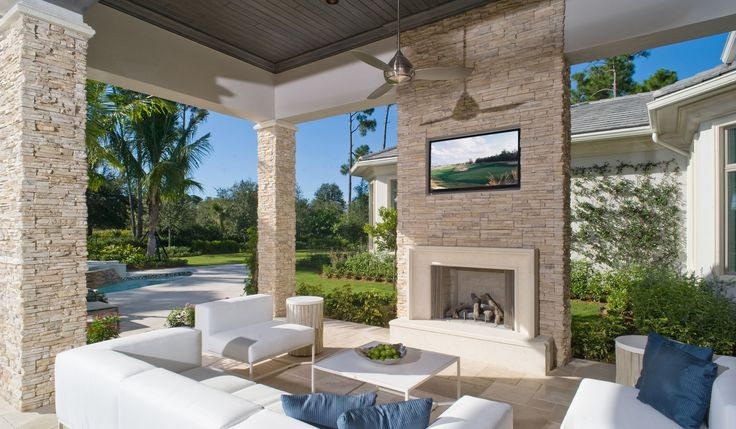 Transitional And Covered Neutral Stone Outdoor Fireplace