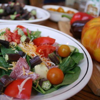 Beautiful spinach salad with purple ocra, heirloom tomatoes, avocado ...