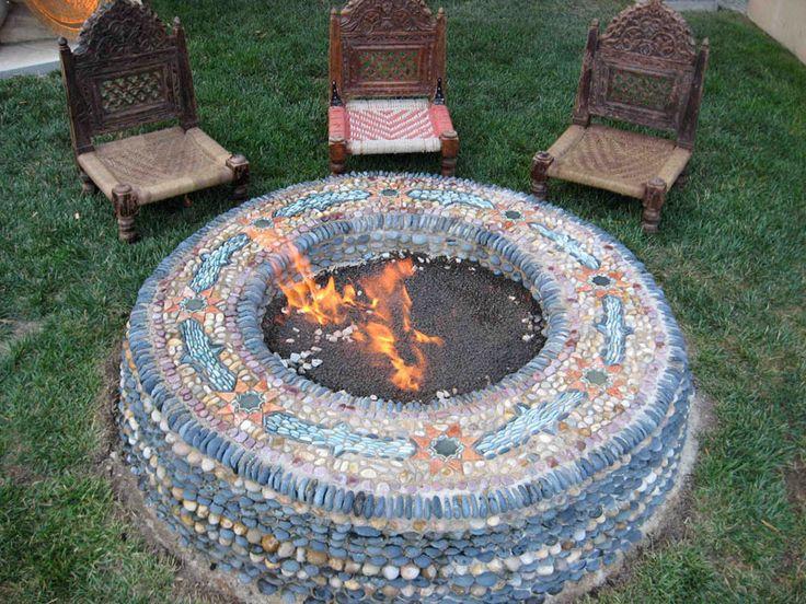 Stone firepit mosaic garden design stones pinterest for Mosaic garden designs