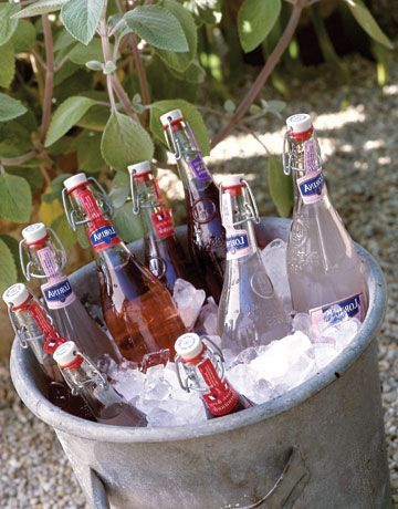 Oversized buckets filled with ice for fancy bottled sodas