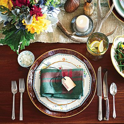 Warm & Rustic Thanksgiving Table Setting | Make each setting unique by using different combinations of vintage china, flatware, and glassware. | SouthernLiving.com