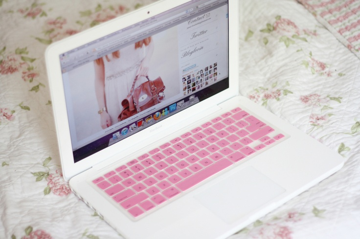 macbook with a pink and white outfit on