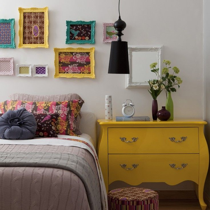 Give a traditional piece of furniture a new life with bright color - notice the frames that tie it in over the bed