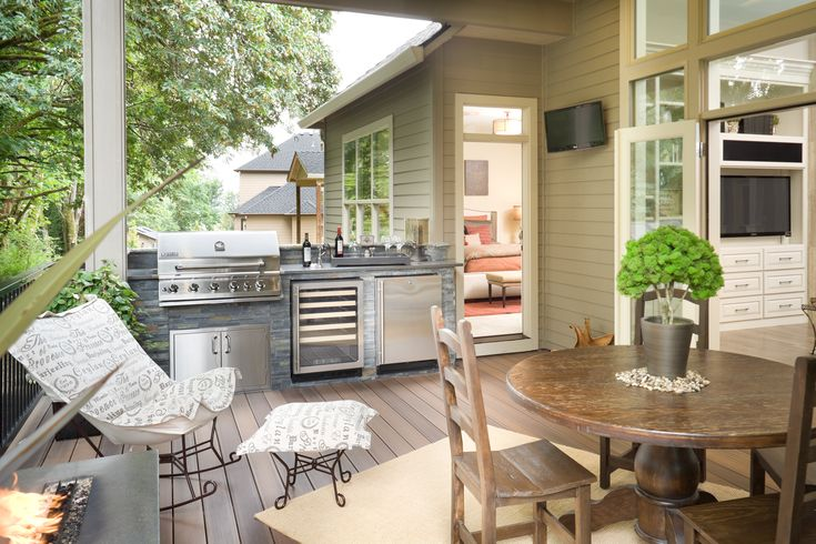 A beautiful outdoor kitchen  perfect for grilling with Wright's Liquid Smoke! |wrightsliquidsmoke.com | #wrightsliquidsmoke #bbq #cookingessentials