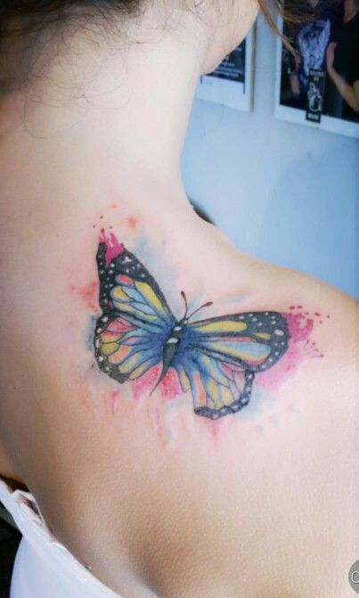 Butterfly tattoo on collarbone
