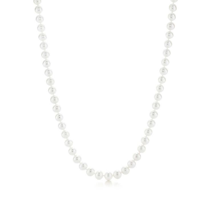 Pearl necklace with a silver clasp and decorative tag pearls 8 9 mm