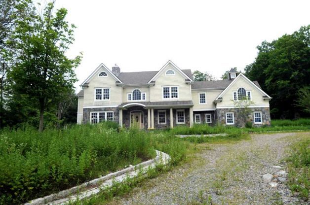 Abandoned homes stick out like sore thumbs in greenwich for Abandoned mansions in new york for sale